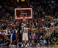 MORNING JOURNAL/DAVID RICHARD.The game clock hits zero as the Cavaliers' tip attempt fails after a missed free throw last night against Detroit.