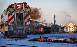 """Metra trains go in and out of the Western Avenue Station in subzero temperatures on Tuesday, January 29, 2019 in Chicago. The tracks are heated with gas-fired switch heaters that help prevent switching problems in extreme weather. Metra spokesperson Meg Reile said, """"They are like giant gas grills."""" Photo by Stacey Wescott/Chicago Tribune/TNS/ABACAPRESS.COM"""