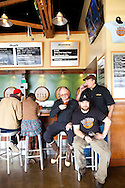 The Cascade Brewing Barrel House in the Southeast neighborhood of Portland, Oregon specializes in barrel-aged sour beers.  Pictured here in the bar are the men behind the beer: (from camera left to right) Ron Gansberg (brewmaster), Beck Jensen (cellerman) and Preston Weesner (barrel blender).