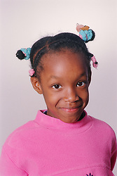 Portrait of young girl smiling,