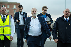 © Licensed to London News Pictures . 25/09/2016 . Liverpool , UK . Labour leader JEREMY CORBYN accompanied by advisors and security guards , walking outside by the docks in Liverpool , at the end of the first day of the Labour Party Conference . Photo credit : Joel Goodman/LNP