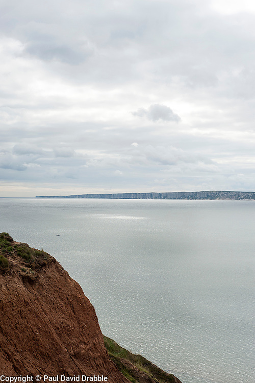 Looking from the cleveland way cliff top path north of Filey across blue sea of Filey Bay to Flambrough Head
