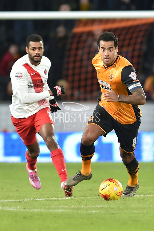 Ricardo Vaz Te of Charlton Athletic and Hull City midfielder Tom Huddlestone (8)  during the Sky Bet Championship match between Hull City and Charlton Athletic at the KC Stadium, Kingston upon Hull, England on 16 January 2016. Photo by Ian Lyall.