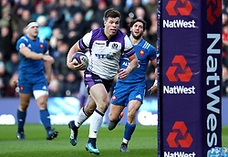Scotland's Huw Jones scores his side's second try of the game during the NatWest 6 Nations match at BT Murrayfield, Edinburgh.
