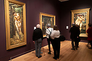 Visitors view paintings from Pre-Raphaelite artist Edward Burne-Jones at Tate Britain art gallery in London, England, United Kingdom. The Pre-Raphaelite Brotherhood was a group of English painters, poets, and art critics, founded in 1848.
