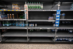 © Licensed to London News Pictures. 05/03/2020. London, UK. Empty shelves on the bottled water aisle. Panic-buying continues to show in a South West London ASDA store as shelves empty out of goods as Prime Minister Boris Johnson appears on This Morning TV show to reassure the public that the Government is doing all it can to fight the coronavirus disease.. Photo credit: Alex Lentati/LNP