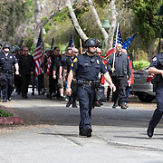 Members of the National Socialist Movement, a Neo Nazi group, rallies in Claremont, California against illegal immigration. Police escort the group into the designated demonstration site. Please contact Todd Bigelow directly with your licensing requests.