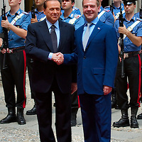 MILAN, ITALY - JULY 23:   Italian Prime Minister Silvio Berlusconi welcomes Russian President Dimitry Medvedev at Palazzo della Provincia on July 23, 2010 in Milan, Italy. Italian Prime Minister Berlusconi and Russian President Medvedev will discuss issues related to Russia's relations with NATO and the EU, energy security, and the development of bilateral trade and economic relations.  ( .***Agreed Fee's Apply To All Image Use***.Marco Secchi /Xianpix. tel +44 (0) 207 1939846. e-mail ms@msecchi.com .<br />  www.marcosecchi.com