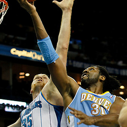 January 6, 2012; New Orleans, LA, USA; Denver Nuggets center Nene (31) shoots over New Orleans Hornets center Chris Kaman (35) during the second half of a game at the New Orleans Arena. The Nuggets defeated the Hornets 96-88.  Mandatory Credit: Derick E. Hingle-US PRESSWIRE