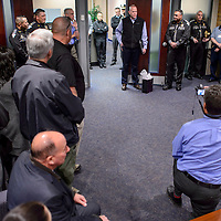 111214       Cable Hoover<br /> <br /> A crowd gathers around Darren Soland while makes a speech at his retirement party at the New Mexico State Police headquarters in Santa Fe Wednesday.