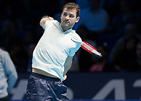 Tennis - 2017 Nitto ATP Finals at The O2 - Day Two<br /> <br /> Group Pete Sampras Singles: Dominic Thiem (Austria) Vs Grigor Dimitrov (Bulgaria)<br /> <br /> Grigor Dimitrov (Bulgaria) contorts his body as he drives his backhand at speed at the O2 Arena <br /> <br /> <br /> COLORSPORT/DANIEL BEARHAM