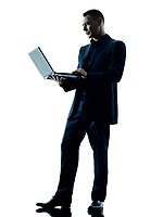 one caucasian business man computer laptop silhouette isolated on white background
