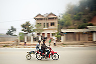 Motorbike pulling wheel barrow in Ban Don Northern Laos South East Asia