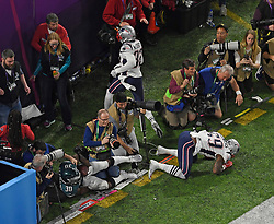 Philadelphia Eagles running back Corey Clement (30) tumbles through the back of the end zone after making a 22-yard touchdown catch in the third quarter on Sunday, February 4, 2018 at U.S. Bank Stadium in Minneapolis, Minn. Defending were New England Patriots linebacker Marquis Flowers (59) and free safety Devin McCourty (32). Photo by Aaron Lavinsky/Minneapolis Star Tribune/TNS/ABACAPRESS.COM