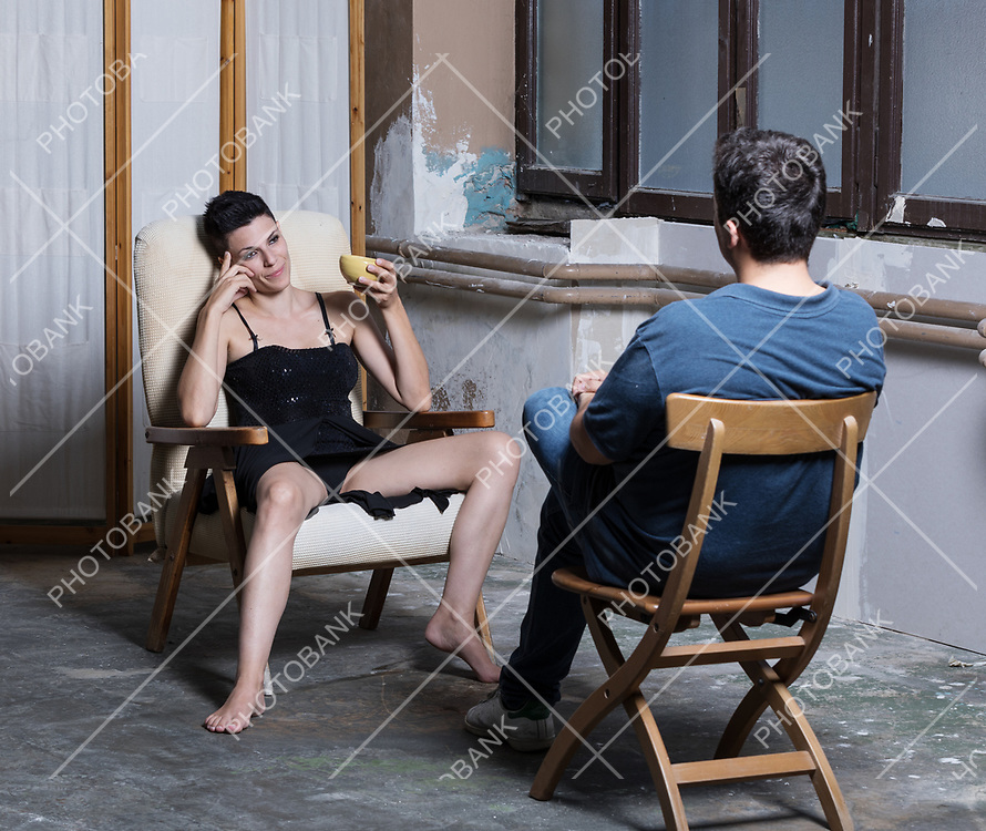 A psychiatrist woman with open legs in a sign of sexual provocation