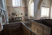 Historic interior of church of Saint John, Inglesham, Wiltshire, England, UK  under the care of the Churches Conservation Trust