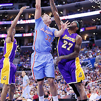 06 April 2014: Los Angeles Clippers forward Blake Griffin (32) goes for the skyhook over Los Angeles Lakers forward Jordan Hill (27) during the Los Angeles Clippers 120-97 victory over the Los Angeles Lakers at the Staples Center, Los Angeles, California, USA.
