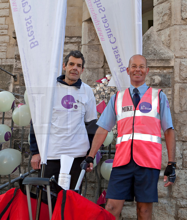 © Licensed to London News Pictures. 16/04/2012. London, U.K..Royal Mail Postman Mike Chandler arrives at the Haven breast cancer support centre in Fulham, London, after his pre-marathon 150 mile run from the Haven centre in his home town of Hereford to raise £20,000 for the charity. He will also run the London Marathon next Sunday 22nd April..Photo credit : Rich Bowen/LNP