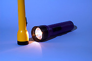 two Flash lights one purple one yellow