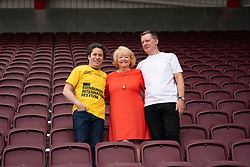 Edinburgh, Scotland, UK. 2 August 2019. Conductor Gustavo Dudamel at Tynecastle Stadium in Edinburgh to conduct the LA Philharmonic Orchestra at the Aberdeen Standard Investments opening Event of the Edinburgh International Festival. Pictured. Gustavo Dudamel, Ann Budge, owner of Hearts,  Fergus Linehan. Iain Masterton/Alamy Live News ++ Editorial Use Only ++