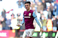 """Aston Villa midfielder Jack Grealish (10) leaves the field holding his """"Skybet"""" man of the match trophy during the EFL Sky Bet Championship match between Aston Villa and Birmingham City at Villa Park, Birmingham, England on 11 February 2018. Picture by Dennis Goodwin."""