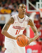 Feb 16, 2013; Fayetteville, AR, USA; Arkansas Razorbacks guard BJ Young (11) looks to make a pass during a game against the Missouri Tigers at Bud Walton Arena. Arkansas defeated Missouri 73-71. Mandatory Credit: Beth Hall-USA TODAY Sports