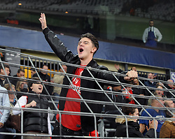 Arsenal fans cheer as their side win late in the game with a goal from Arsenal's Lukas Podolski - Photo mandatory by-line: Dougie Allward/JMP - Mobile: 07966 386802 - 22/10/2014 - SPORT - Football - Anderlecht - Constant Vanden Stockstadion - R.S.C. Anderlecht v Arsenal - UEFA Champions League - Group D