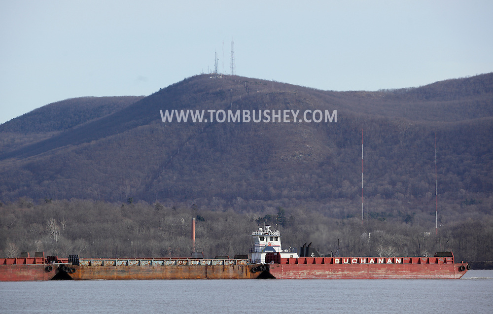 Newburgh, New York - The tugboat Buchanan 12 pushes barges up the Hudson Riveron Dec. 29, 2011. Mount Beacon is in the background. ©Tom Bushey / The Image Works