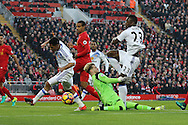 Liverpool Goalkeeper Loris Karius makes a save from Steven Pienaar of Sunderland (l). Premier League match, Liverpool v Sunderland at the Anfield stadium in Liverpool, Merseyside on Saturday 26th November 2016.<br /> pic by Chris Stading, Andrew Orchard sports photography.