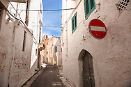 The alleys and narrow streets of the white city of Ostuni, Puglia, South Italy. .<br /> <br /> Visit our ITALY HISTORIC PLACES PHOTO COLLECTION for more   photos of Italy to download or buy as prints https://funkystock.photoshelter.com/gallery-collection/2b-Pictures-Images-of-Italy-Photos-of-Italian-Historic-Landmark-Sites/C0000qxA2zGFjd_k<br /> .<br /> <br /> Visit our MEDIEVAL PHOTO COLLECTIONS for more   photos  to download or buy as prints https://funkystock.photoshelter.com/gallery-collection/Medieval-Middle-Ages-Historic-Places-Arcaeological-Sites-Pictures-Images-of/C0000B5ZA54_WD0s