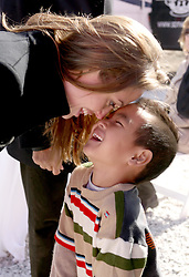 Dec 03 2007. New Orleans, Louisiana. Lower 9th Ward.<br /> Angelina Jolie and adopted son Maddox share some tender moments backstage when Brad Pitt revisits the Lower 9th ward, devastated by Hurricane Katrina to present 'Make it Right' where architects' designs are unveiled to the public.<br /> Photo credit; Charlie Varley.