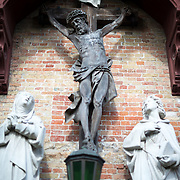 A statue of the crucifixion of Christ adorns the outside of the Church of Our Lady, Bruges.