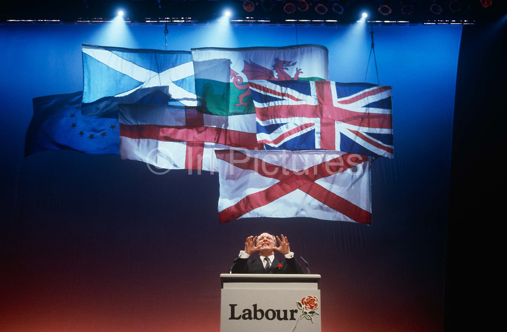Leader of the Labour party, Neil Kinnock makes his infamous speech during the Labour Party election rally on 1st April 1992 in Sheffield, England. In the 1992 election, Labour made considerable progress – reducing the Conservative majority to just 21 seats. It came as a shock to many when the Conservatives won a majority, but the triumphalism perceived by some observers of a Labour party rally in Sheffield together with Kinnocks performance on the podium may have helped put floating voters off.