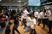 The New York Giant's Victor Cruz hosting the first ever in-store Salsa dance lesson at the Flagship Modell's Times Square store...Photo by Robert Caplin...