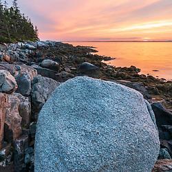 Isle au Haut sunset, Acadia National Park, Maine. A glacial erratic on the shores of Duck Harbor.