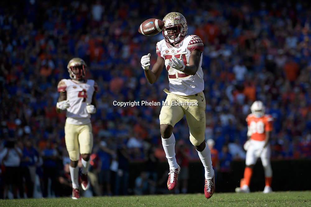 A pass falls incomplete in front of Florida State defensive back Hamsah Nasirildeen (23) during the second half of an NCAA college football game against Florida Saturday, Nov. 25, 2017, in Gainesville, Fla. FSU won 38-22. (Photo by Phelan M. Ebenhack)