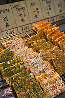 Sembei, Japanese rice crackers, can be found flavored with a wide array of flavours including soy sauce, seaweed, kelp, sesame seeds, soybeans plus a huge range of more modern flavors like cheese, chocolate and even kimchee. Smaller sembei often come mixed with other ingredients such as peanuts or pine nuts.  Traditional sembei are large, round and savory.  Sembei aren't all savory though - sweet sembei are made with wheat flour instead of rice flour.