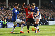 Stephane Sessegnon of West Bromwich Albion is squeezed out by  Bryan Oviedo (l) and Tom Cleverley of Everton. Barclays Premier League match, Everton v West Bromwich Albion at Goodison Park in Liverpool on Saturday 13th February 2016.<br /> pic by Chris Stading, Andrew Orchard sports photography.