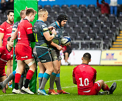 Dan Evans of Ospreys celebrates scoring his sides first try<br /> <br /> Photographer Simon King/Replay Images<br /> <br /> European Rugby Champions Cup Round 5 - Ospreys v Saracens - Saturday 11th January 2020 - Liberty Stadium - Swansea<br /> <br /> World Copyright © Replay Images . All rights reserved. info@replayimages.co.uk - http://replayimages.co.uk