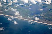 Coastline sandy beach lagoon farmland seen from the air over western Denmark