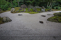 """Nirvana Shakkei Garden at Shinnyodo -  Three gardens are to be found at <br /> Shinnyodo Temple.  The first is the Nehan """"Nirvana"""" garden and was built in the classic karesansui rock garden style in 1988. It uses the shakkei borrowed landscape technique to include Mt. Hiei in its design. The second garden was designed by Shigemori Chisao - Its modern geometrical style is similar in design to his father renowned landscape architect and garden designer Shigemori Mirei. The third is a small tea garden, with its own tea ceremony hut."""
