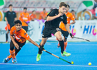 LUCKNOW (India) -   Junior World Cup hockey  U21 for men .  MALAYSIA v NEW ZEALAND  (place 9-12 ). Dominic Newman (NZL) with Najmi Jazlan (MAS) COPYRIGHT  KOEN SUYK