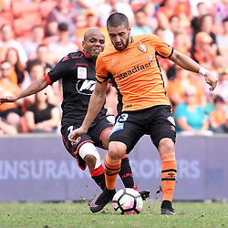 BRISBANE, AUSTRALIA - DECEMBER 11: Dimitri Petratos of the Roar is fouled by Henrique of Adelaide United during the round 10 Hyundai A-League match between the Brisbane Roar and Adelaide United at Suncorp Stadium on December 11, 2016 in Brisbane, Australia. (Photo by Patrick Kearney/Brisbane Roar)