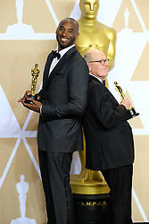 Winners and presenters in the Press Room at the 90th Academy Awards Ceremony at the Dolby Theatre in Los Angeles, California. 04 Mar 2018 Pictured: Kobe Bryant and Glen Keane. Photo credit: Jaxon / MEGA TheMegaAgency.com +1 888 505 6342