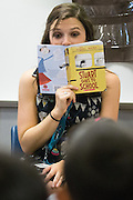 Third grade teacher Laura Polden reads a book with her class during the first day of school at Zanker Elementary School in Milpitas, California, on August 19, 2013. (Stan Olszewski/SOSKIphoto)