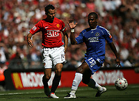 Photo: Rich Eaton.<br /> <br /> Manchester United v Chelsea. FA Community Shield. 05/08/2007. Man United's Ryan Giggs (l) tries to find a way past Chelsea's Florent Malouda (r).