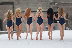 © licensed to London News Pictures. London, UK 21/01/2013. Hilton Hotels & Resorts create a pop-up beach resort on the day that many consider to be the most depressing day of the year in Potter's Field, London. 30 models with swimwear enjoying the beach in the snowing weather. Photo credit: Tolga Akmen/LNP