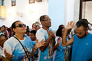 People workshipping in Church. Often the lines between Candomble and Catholicism are blurred. This is especially true with the Sao Lazaro event in late January in Salvador, Bahia, Brazil, the city which is known as the home of Candomble. Sao Lazaro represents healing and the sick.