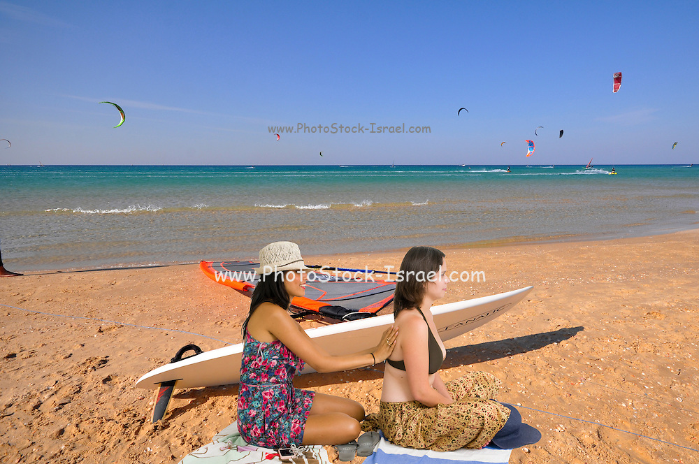 Two multiracial women on the beach