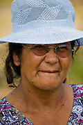 Solange Da Silva Correia, a rancher's wife who lives in riverside house near the town of Caviana in Amazonas, Brazil. (Featured in the book What I Eat: Around the World in 80 Diets.) The caloric value of her day's worth of food on a typical day in the month of November was 3400.  She is 49 years of age; 5 feet 2.5 inches tall; and 168 pounds.  She and her husband, Francisco live outside the village of Caviana with three of their four grandchildren in a house built by his grandfather. They raise cattle to earn income (and sometimes a sheep or two to eat themselves) but generally they rely on their daily catch of fish, and eggs from their chickens, for animal protein. They harvest fruit and Brazil nuts on their property and buy rice, pasta, and cornmeal from a store in Caviana. They also purchase Solange's favorite soft drink made from guarana (a highly caffeinated berry indigenous to the country).  MODEL RELEASED.